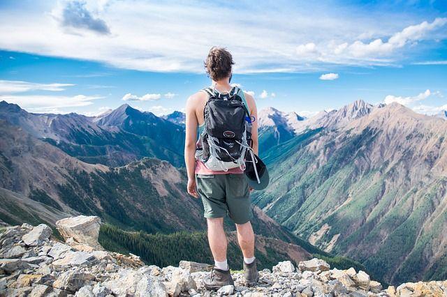 adventure man backpack hills trekking mountains